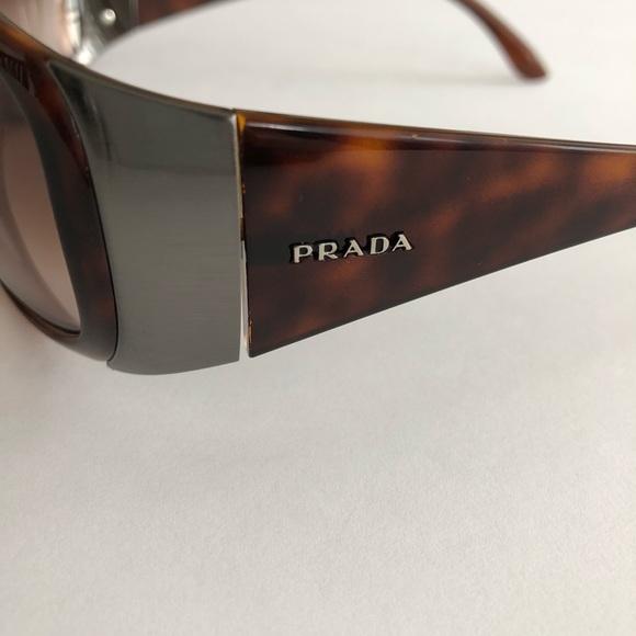 928221a56a94 Prada pre-owned authentic sunglasses. M 5c45f1f2aa877020cd41d4b3